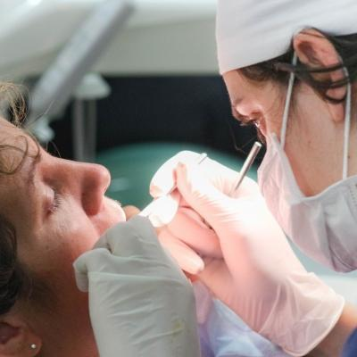 A local dentist treats a patient in Argentina as Projects Abroad dental interns observe for their Dentistry internship